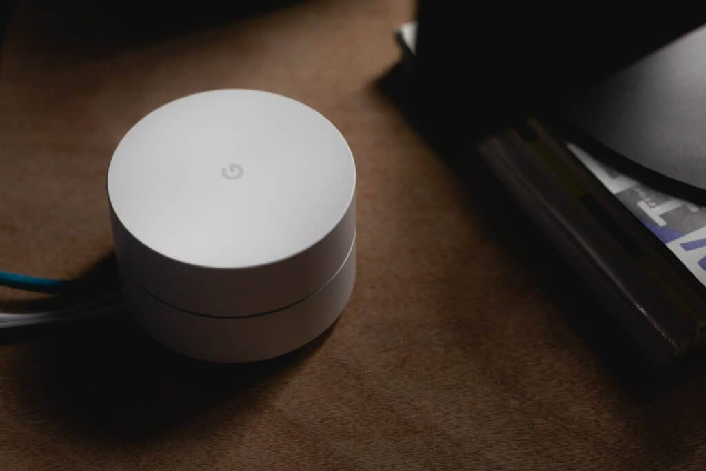 a white smart home hub on the table